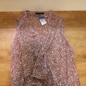 Woman's fringe sleeveless sweater
